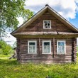 Old wooden house in Russian village — Stock Photo #80635182
