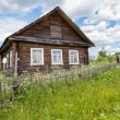 Old wooden house in Russian village — Stock Photo #80635086