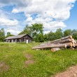 Old wooden house in Russian village — Stock Photo #80635312