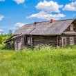 Old wooden house in Russian village — Stock Photo #80635332