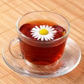 Herbal teas in cup with chamomile — Stock Photo