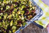 Broiled brussel sprouts with almonds and cranberries — Stock Photo