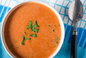 Bowl of tomato and herb soup — Stock Photo