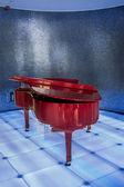 Red piano on blue club scene. — Stock Photo