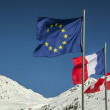 Flags of European Union and  France in the french Alps. — Stock Photo #58094615