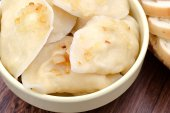 Dumplings with fried onions close up — Stock Photo