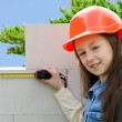 Child in a protective construction helmet — Stock Photo #69310043