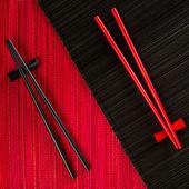 Chopsticks on bamboo mat — Stock Photo