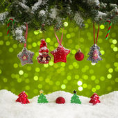 Christmas decoration on green bakground — Stock Photo