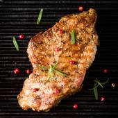 Beef steak on grill top view — Stock Photo