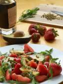 Avocado with strawberries    — Stock Photo