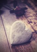 Vintage picture of heart on a wooden background with red rose. — Stock Photo