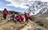 Porters with heavy load after crossing Cho La Pass in Himalayas. — Stock Photo