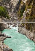 Hanging suspension bridge in Himalaya mountains, Nepal. — Stock Photo