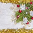 Christmas background with angels, decoration on a wooden board. — Stock Photo #54050753