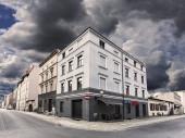 Rainy sky over street corner in Chelmno, Poland.  — Stockfoto