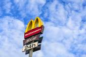 McDonalds logo on blue sky. — Stock Photo