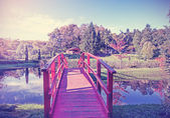 Vintage picture of red bridge in garden. — Stock Photo