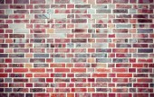 Red grunge brick wall  background with vignetted corners. — Stock Photo