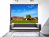 Empty room with sofa and beautiful landscape view through window — Stock Photo