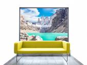 Empty room with yellow sofa and mountain view through window. — Stock Photo