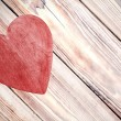 Wooden red heart on timbered background, space for text. — Stockfoto #57911693
