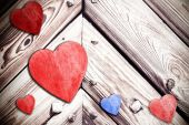 Wooden hearts on timbered background, space for text. — Stock Photo