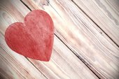 Wooden red heart on timbered background, space for text. — Stock Photo