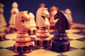 Vintage filtered picture of chess, two against one concept. — Stock Photo