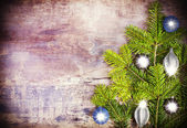 Christmas background, decoration on a rustic wooden board. — Stock Photo