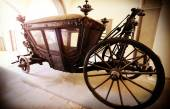 Retro vintage filtered picture of an old wooden carriage. — Stock Photo