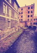 Vintage filtered photo of ruined building by the river, Bialogar — Stockfoto