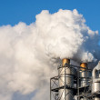 Smoke clouds from a chimney against blue sky. — Stock Photo #59557545