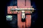Retro vintage style picture of wooden door with lock. — Stock Photo
