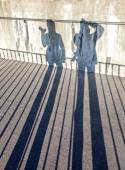 Shadows of a couple photographers with cameras. — Stock Photo