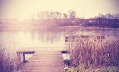 Vintage retro toned image of lake in autumn. — Stock Photo