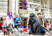 Fans in costumes waiting for opening the 2014 Comic Fiesta in Kuala Lumpur. — Stock Photo