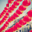 Retro filtered chinese red paper lanterns against blue sky. — Stock Photo #63488393