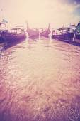 Retro filtered picture of boats on tropical beach, copy space. — Stock Photo