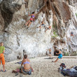 Rock climbers climbing the wall on Railay beach. — Stock Photo #64639389