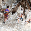 Rock climbers climbing the wall on Railay beach. — Stock Photo #64639497