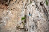 Young female rock climber on incredible wall, Railay Beach — Stock Photo