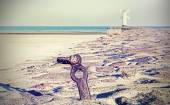 Seaside on cross processed retro style picture. — Stock Photo