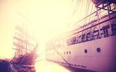 Vintage toned sailing boats at sunrise background. — Stock Photo