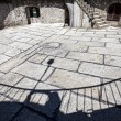 Shadows on stone floor of medieval castle ruins. — Stock Photo #75666827