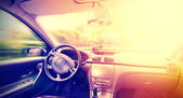 Vintage toned picture of a driving car interior, space for text. — Stock Photo