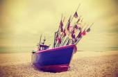Retro instagram style photo of fishing boat on a beach. — Foto Stock
