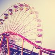 Vintage stylized picture of ferris wheel at sunest. — Stock Photo #76961955