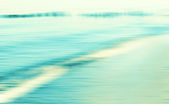 Motion blurred sea background, retro cross processed colors. — Stock Photo