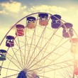 Retro vintage stylized picture of ferris wheel at sunset. — Stockfoto #77909680